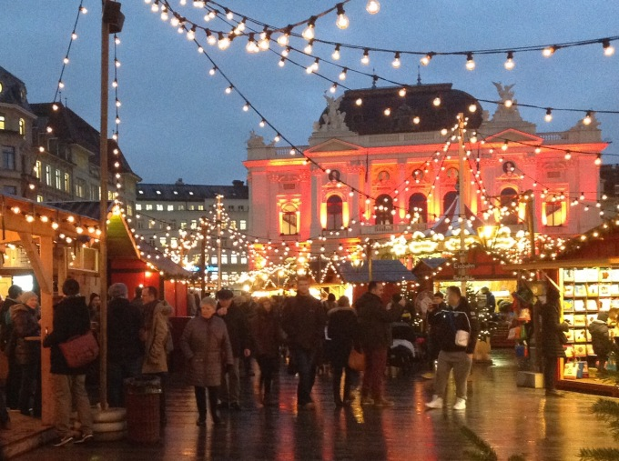 magical christmas market at zurich sechselutenplatz in front of the opera house